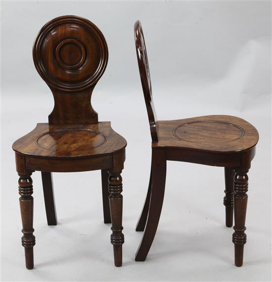 A pair of Regency mahogany hall chairs, W.1ft 4in. H.2ft 8in.