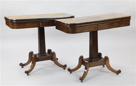 A pair of Regency crossbanded mahogany tea tables, W.2ft 11in. D.1ft 5in. H.2ft 6in.