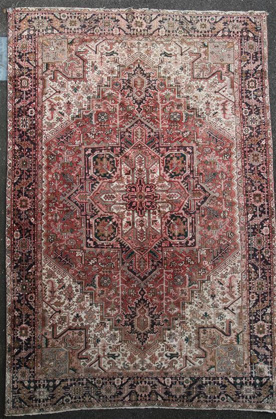 A Heriz carpet, 13ft 4in by 9ft 10in.