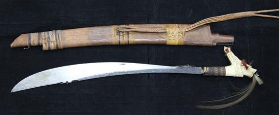 A Dayak stag horn-handled Mandau (head-hunter's sword), wood scabbard, late 19th / early 20th century, total length 78.5cm (30.9in.)