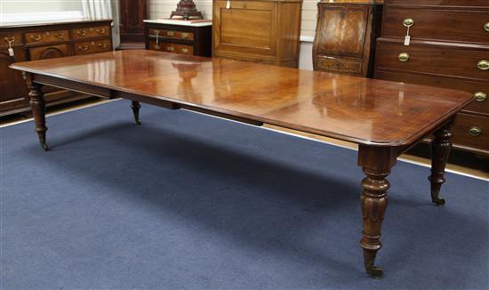 Johnstone & Jeanes. A handsome early Victorian mahogany extending dining table, Extended to 12ft 6in. x 4ft 6in. H.2ft 6in.