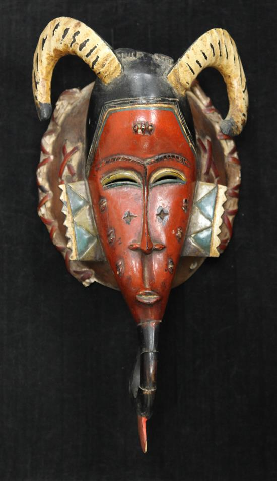 A Guro Ivory Coast painted wood mask, 16in.