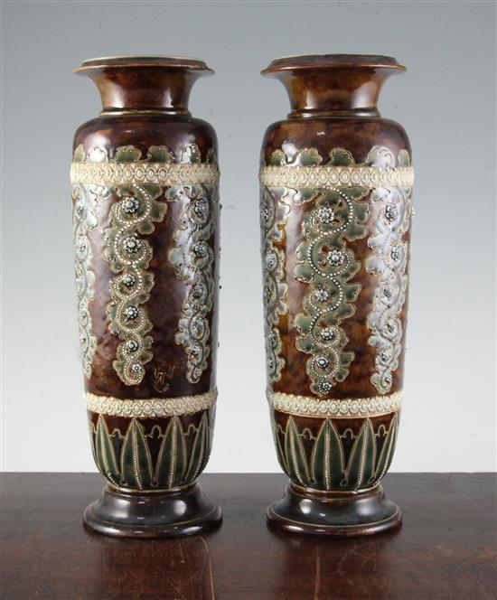George Tinworth for Doulton Lambeth. A pair of stoneware vases, c.1871, height 32cm (12.5in.), one rim damaged