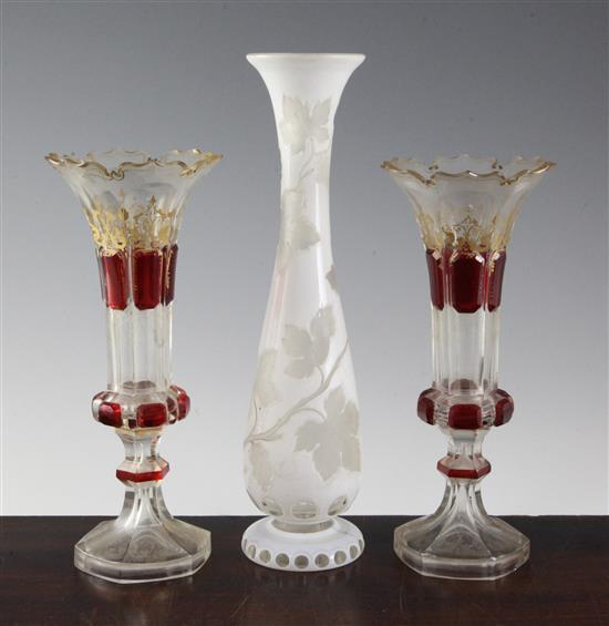A pair of Bohemian vases and a a similar white overlaid glass, late 19th century, 23.5cm (9.25in.) & 29.5cm (