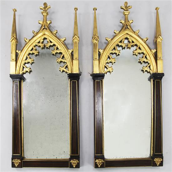A pair of Victorian brass strung rosewood and parcel gilt wall mirrors, W.1ft 6in. H.3ft 10in.