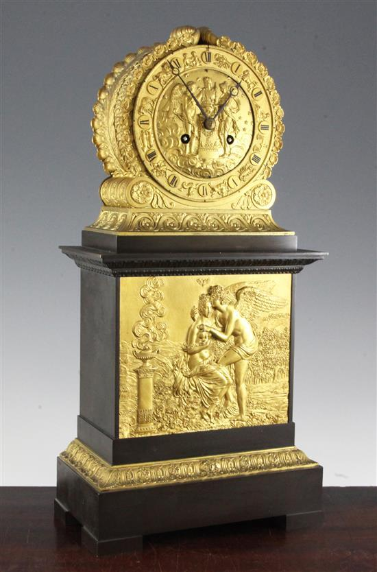 A 19th century French bronze and ormolu Empire style mantel clock, 18.75in.