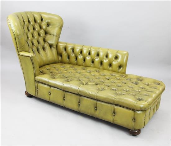 A Victorian buttoned green leather chaise longue, W.5ft 6in. H.3ft 1in.