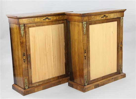 A pair of Victorian marquetry inlaid walnut pier cabinets, W.2ft 7in. D.1ft H.3ft 2in.