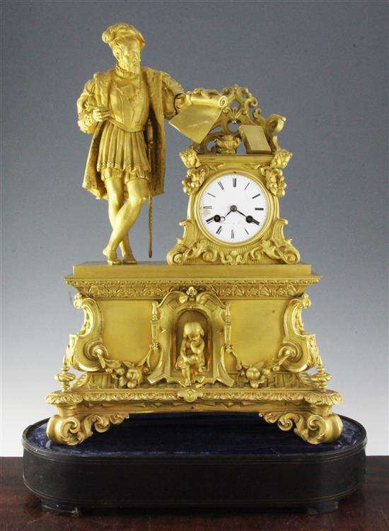 A 19th century French ormolu mantel clock, clock 22.5in., with ebonised stand