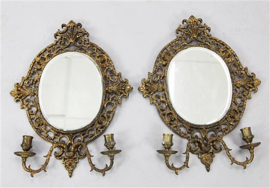 A pair of Victorian gilt cast brass girandoles, 20in.