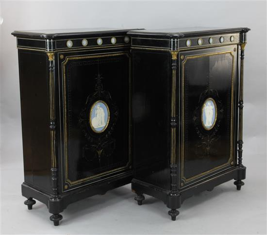 A pair of Victorian ebonised pier cabinets, W.2ft 8in. D.1ft 5in. H.3ft 10in.
