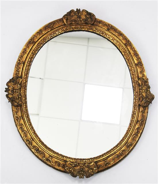 A Victorian oval giltwood and gesso wall mirror, W.2ft 6in. H.3ft 1in.
