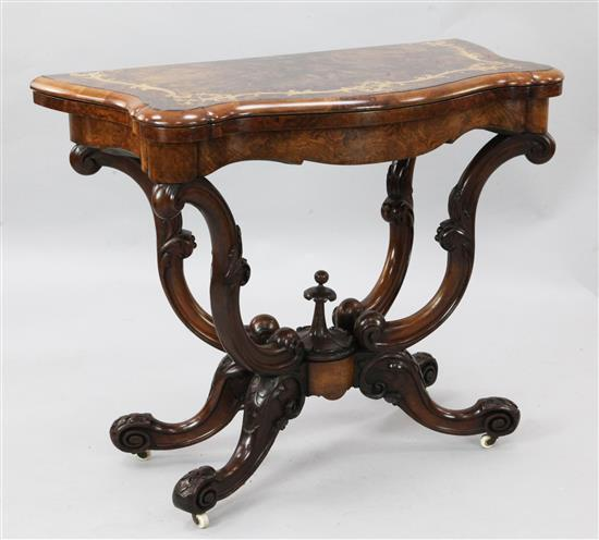 A Victorian marquetry inlaid walnut card table, W.3ft D.1ft 6in. H.2ft 5in.