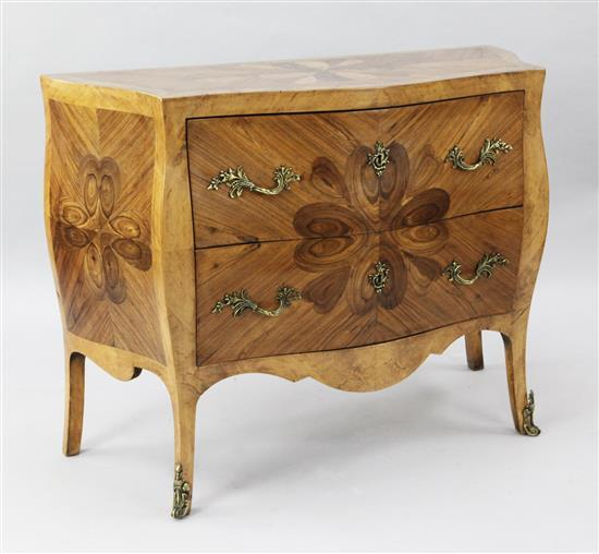 A late 19th century French oyster veneered and kingwood serpentine commode, W.3ft 6in. D.1ft 5in. H.2ft 9in.