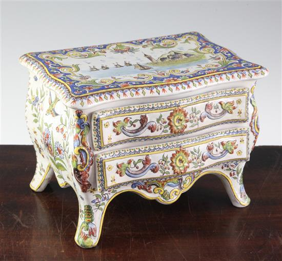 A French faience model of a two drawer commode, late 19th century, width 20.5cm (8in.)