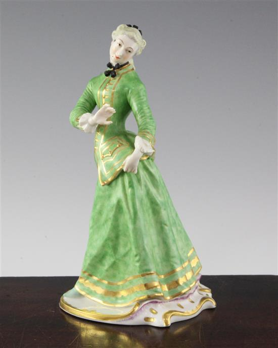 A Nymphenburg porcelain figure of Julia, after the Commedia Dell'arte figure by Bustelli, 20th century, height 21.5cm (8.5in.)
