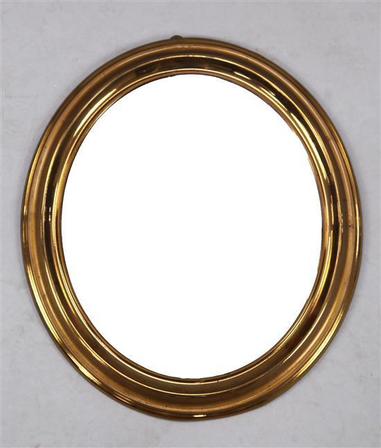 A Biedermeier brass framed oval wall mirror, W.1ft 5in. H.1ft 3in.