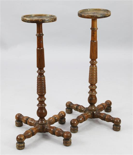 A pair of mid 19th century turned fruitwood torcheres, H.2ft 8in.