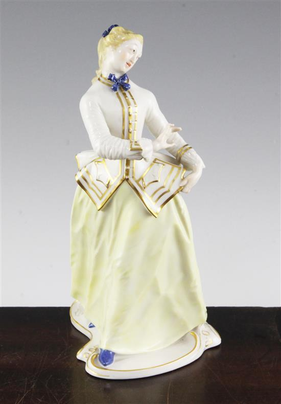 A Nymphenburg porcelain figure of Julia, after the Komedia Del arte figure by Bustelli, 20th century, 8.25in.
