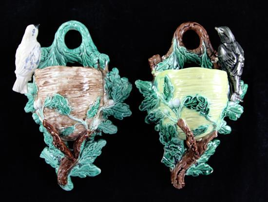 A pair of French majolica birds nest and oak branch wall pockets, late 19th century, 11.5ins