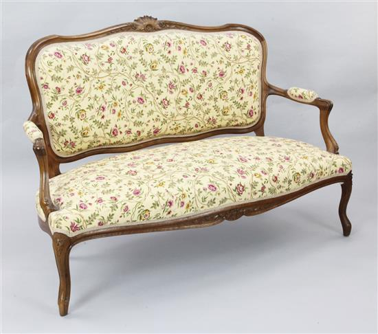 A French Louis XVI style walnut settee, W.4ft 7in. H.3ft 6in.