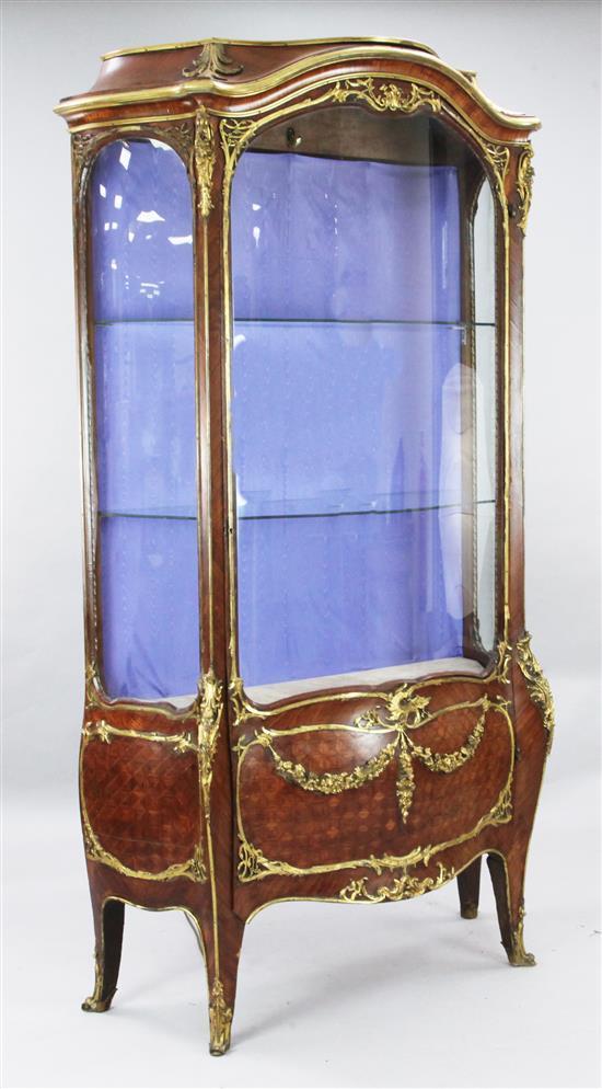 A Louis XVI style ormolu mounted kingwood serpentine vitrine, W.3ft 8in. D.1ft 8in. H.6ft 8in.