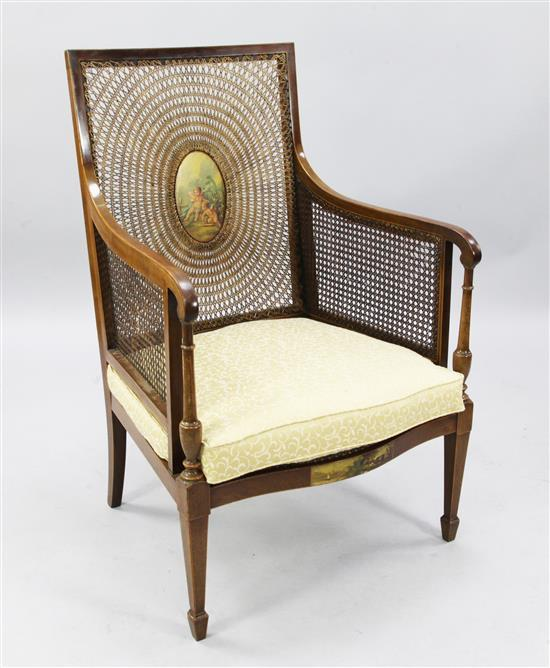An Edwardian painted mahogany bergere armchair, H.3ft 4in.