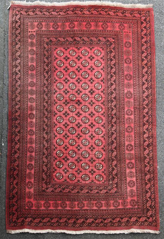 A Bokhara carpet, 9ft 6in by 6ft 10in.