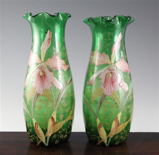 A pair of Bohemian or French enamelled green glass vases, c.1910, height 29.2cm (11.5in.)
