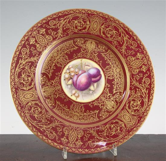 A Royal Worcester fruit painted crimson ground plate, mid 20th century, 27cm (10.4in.)