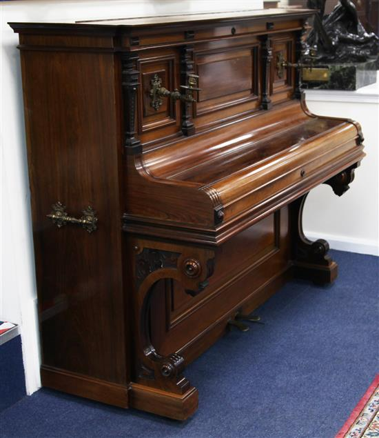 A late Victorian rosewood cased Bluthner upright piano, W.5ft 2in. D.2ft 3in. H.4ft 3in.