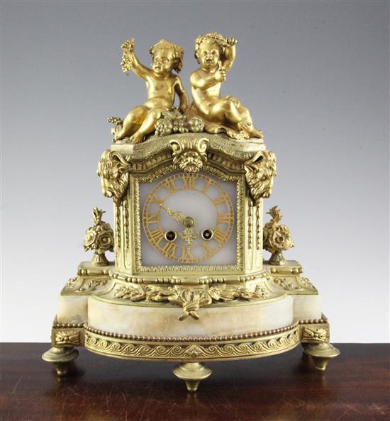 A 19th century French ormolu mounted onyx mantel clock, H.14in.