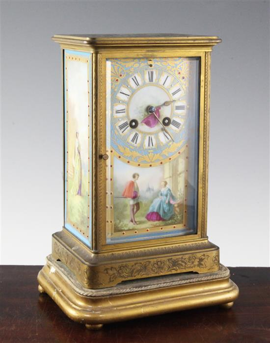 An early 20th century ormolu and jewelled porcelain four glass mantel clock, 10in.
