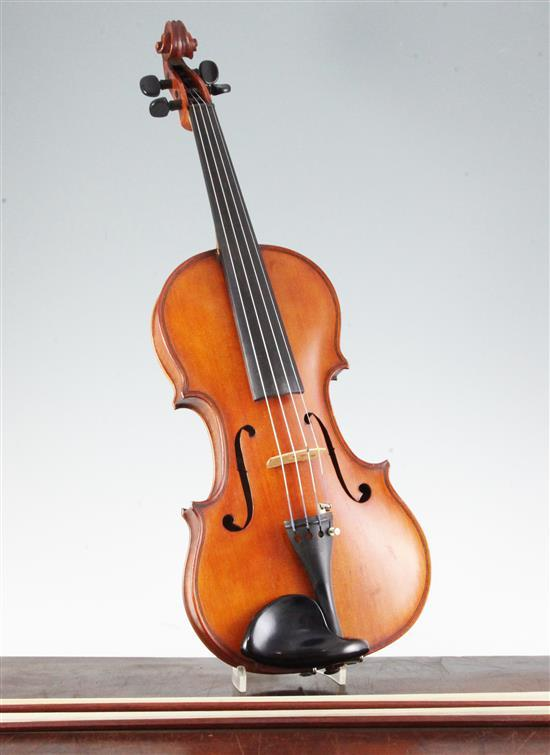 An early 20th century violin, with handwritten label stating made by J.K. Monk, Lewisham,
