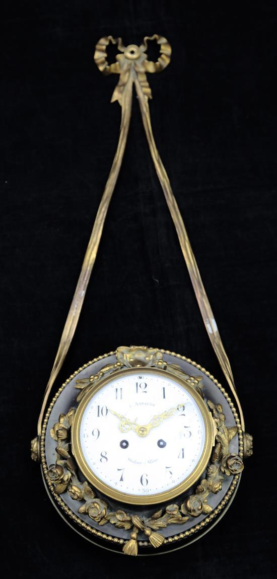 A French bronzed and gilt metal wall clock, 28in.