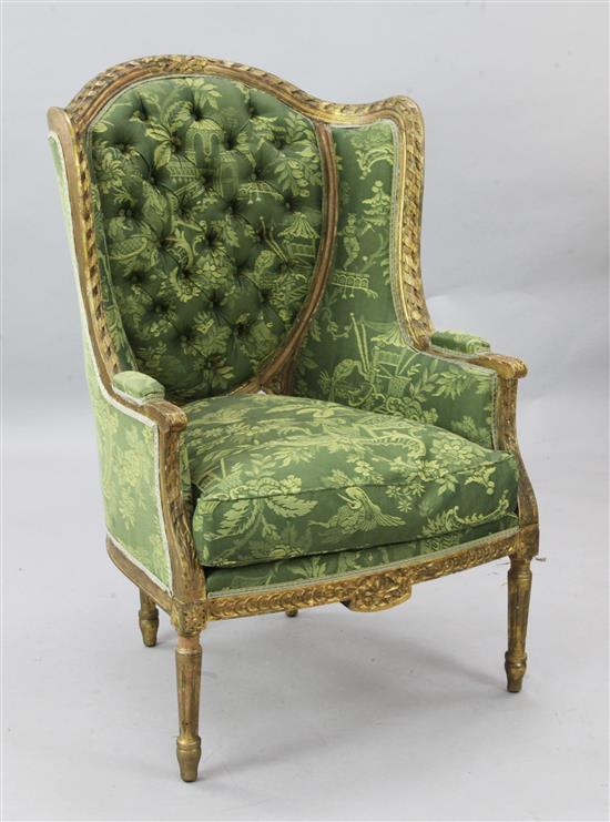 A Louis XVI style giltwood armchair, W.2ft 4in. H.3ft 7in.
