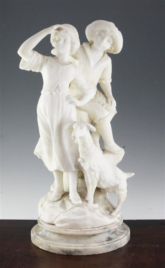 A late 19th century carved alabaster group of two children with a goat, 21in.