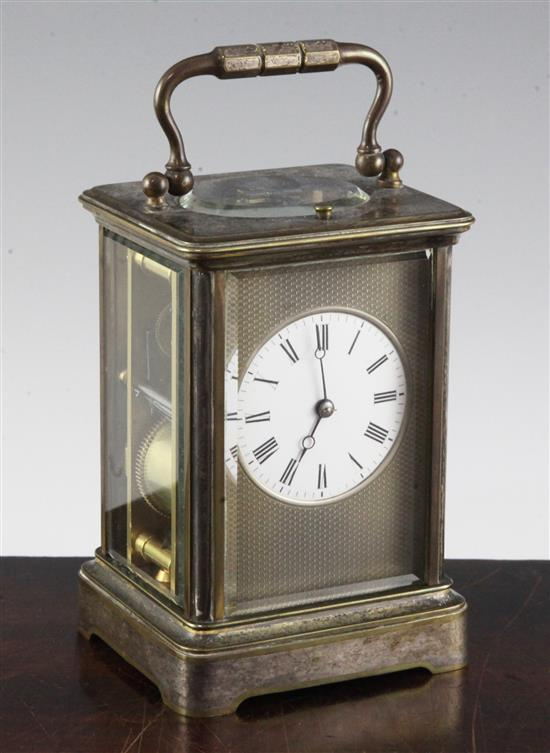 An Edwardian silvered brass hour repeating carriage clock, 5.5in.