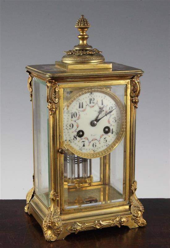 An early 20th century French ormolu four glass mantel clock, height 10in.