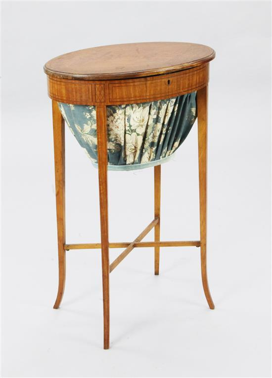 An Edwardian inlaid satinwood work table, W.1ft 7in. D.1ft 2in. H.2ft 5in.