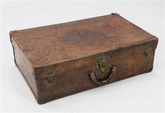 An early 20th century Louis Vuitton brown leather suitcase, 28 x 17 x 9in.