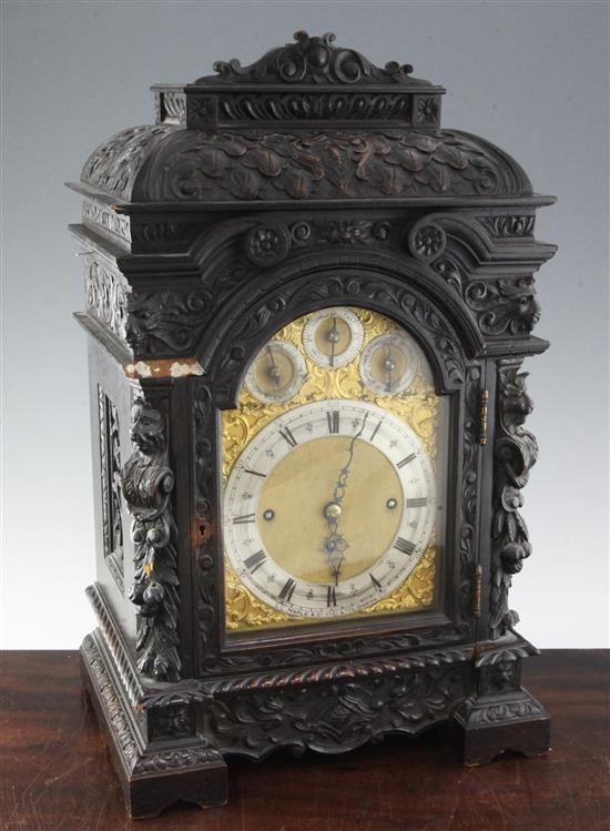 A late 19th century Maple & Co carved and ebonised oak chiming bracket clock, 22in., overall height 34in.