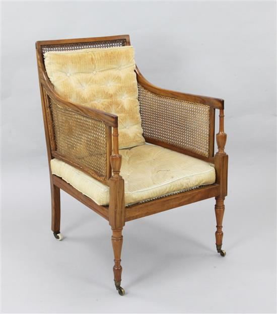 An Edwardian Sheraton style satinwood bergere armchair, W.2ft D.2ft 5in. H.3ft 3in.