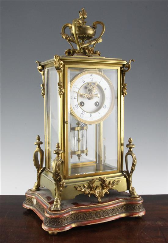 An early 20th century ormolu four glass mantel clock, 17in.