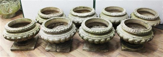 A set of eight Doulton composition stone garden urns, H.1ft 2in. Diam. 1ft 5in.