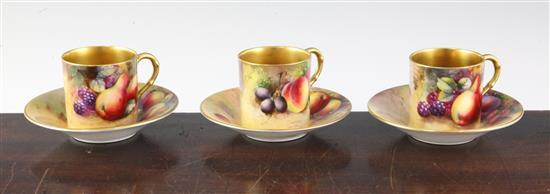 Three Royal Worcester fruit painted coffee cans and saucers, early 20th century, cans 2in.