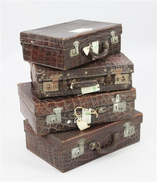 A pair of crocodile skin suitcases & 2 similar cases