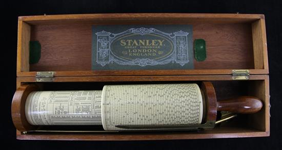 A Stanley Fuller's calculator in fitted case, 17in.