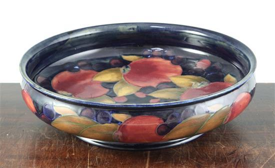 A William Moorcroft pomegranate blue ground footed shallow bowl, diameter 29cm