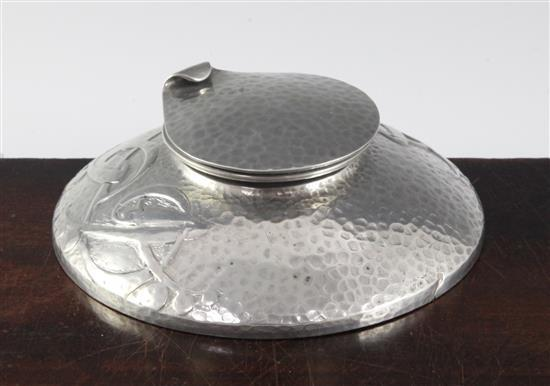 A Colkets English pewter inkwell, in the manner of Archibald Knox, 5in.